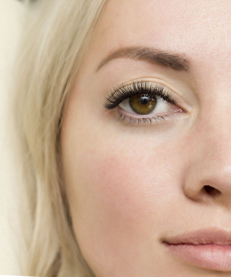 close-up shot of a woman's face with long eyelashes