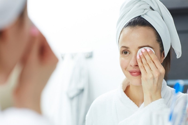 woman removing mascara without makeup remover